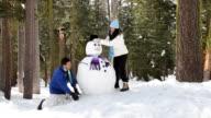 Couple Building Snowman video