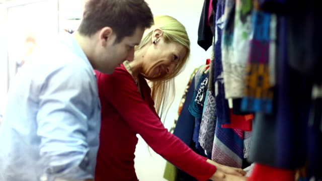 Couple buying clothes. video