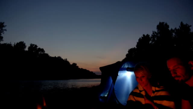 HD CRANE: Couple Camping By The River video