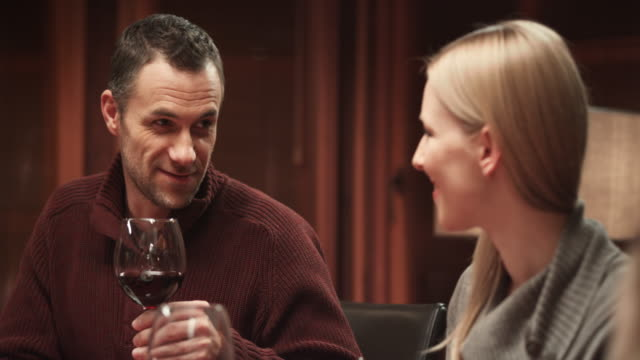 Couple chatting at the Thanksgiving table video