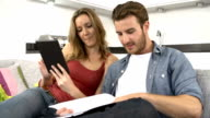 Couple Checking Personal Finances Using Digital Tablet video
