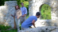 Couple comes in to the castle ruins video