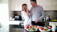 Couple cooking at home video