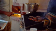Couple cooking hamburgers on the barbecue video