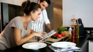 Couple cooking together at home video
