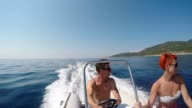 SLO MO POV Couple cruising on a motorboat video