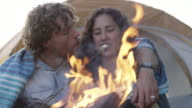 Couple Cuddling by the Fire video