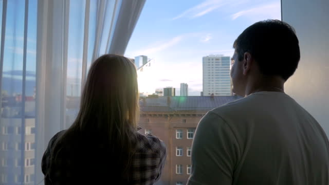 Couple Cuddling by the Window video