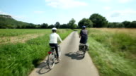 Couple cycling on road in France video