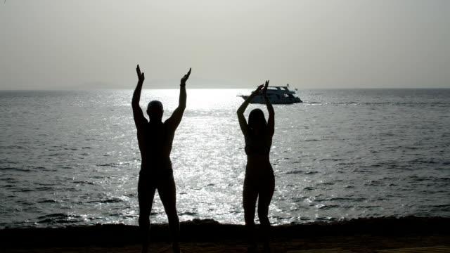 couple dancing at dawn near the sea video