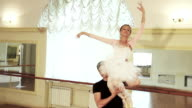 Couple dancing ballet, young male holding woman on his shoulder video