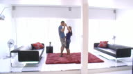 Couple dancing in modern home video