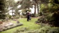 Couple dancing in the garden video
