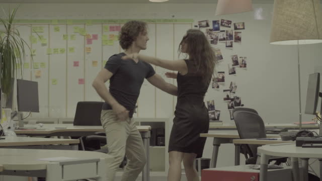 Couple dancing in the office. video
