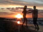 Couple dancing salsa at the beach video