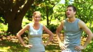 Couple deciding what route to jog video