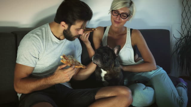 Couple dining with pet video