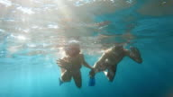 POV Couple diving in sunshine holding hands video