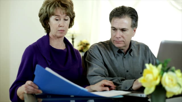 Couple Doing Bills on the Laptop video