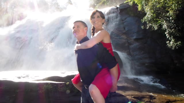 Couple Doing Piggyback In River video