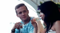 Couple drinking champagne wine on terrace video