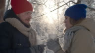Couple Drinking Hot Tea in Winter Forest video