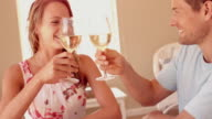 Couple drinking white wine together on holiday video