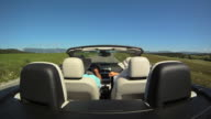HD SLOW-MOTION: Couple Driving A Convertible video