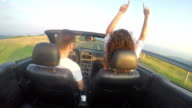 Couple Driving Convertible Cabriolet Along The Mountain Coast Road, SLOW MOTION video
