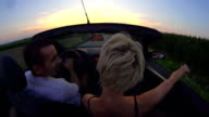HD SLOW MOTION: Couple Driving Late In Convertible video
