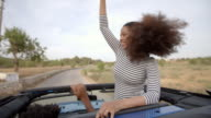 Couple Driving Open Top Car On Country Road video