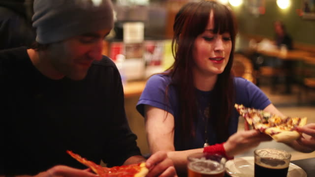 Couple eat pizza video