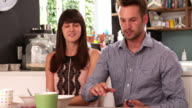 Couple Eating Breakfast Whilst Using Digital Tablet video
