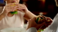 Couple eating fast food in a restaurant video