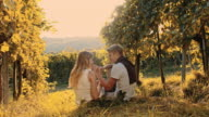 Couple eating grapes in the vineyard video