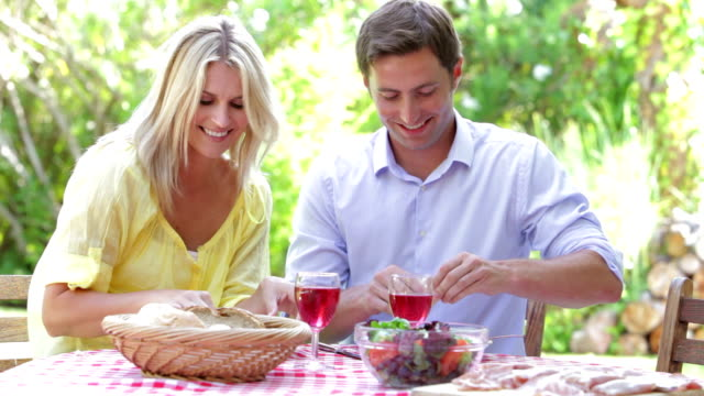 Couple Eating Meal Outdoors video