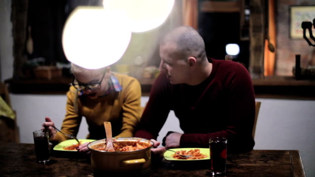 Couple eating pasta at home video