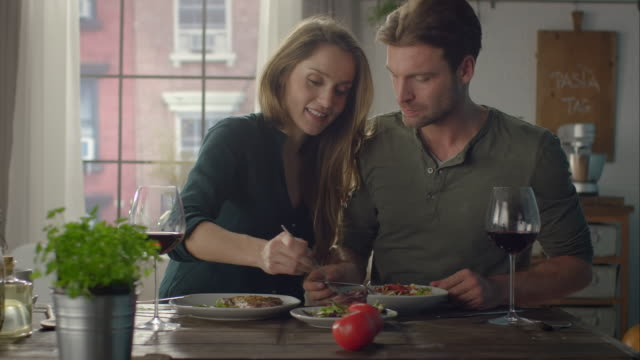 Couple eating self-made food in the kitchen video