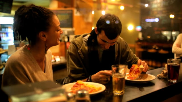 Couple eats pizza together video