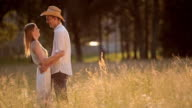 SLO MO Couple embracing each other in the summer meadow video