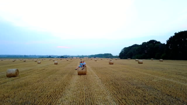 Couple Embracing Near Hay video