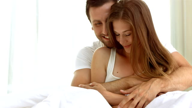HD: Couple Embracing On A Bed video