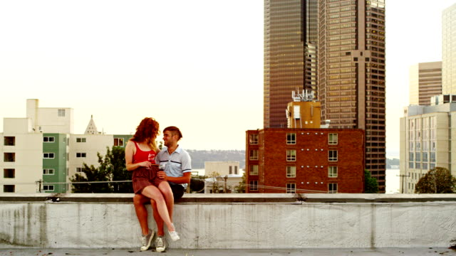 Couple embracing on rooftop of building video