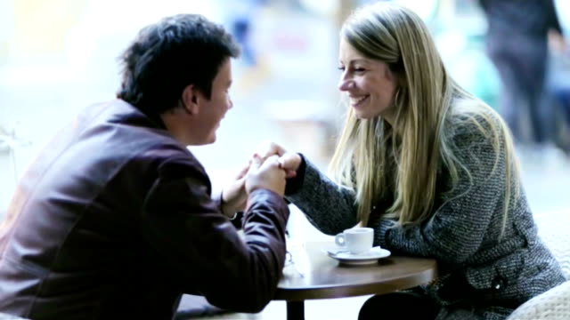 Couple enjoying coffee in a restaurant video