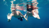 POV Couple enjoying diving together video