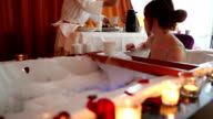 Couple enjoying Jacuzzi and buffet in hotel room video