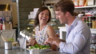 Couple Enjoying Lunch In Restaurant Shot On R3D video