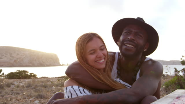 Couple Enjoying Picnic On Cliffs By Sea Shot On R3D video