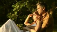 Couple enjoying sunset video
