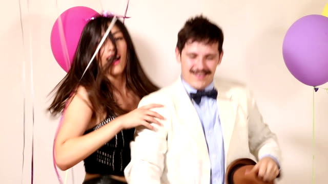 Couple fainting from too much dancing in party photo booth video